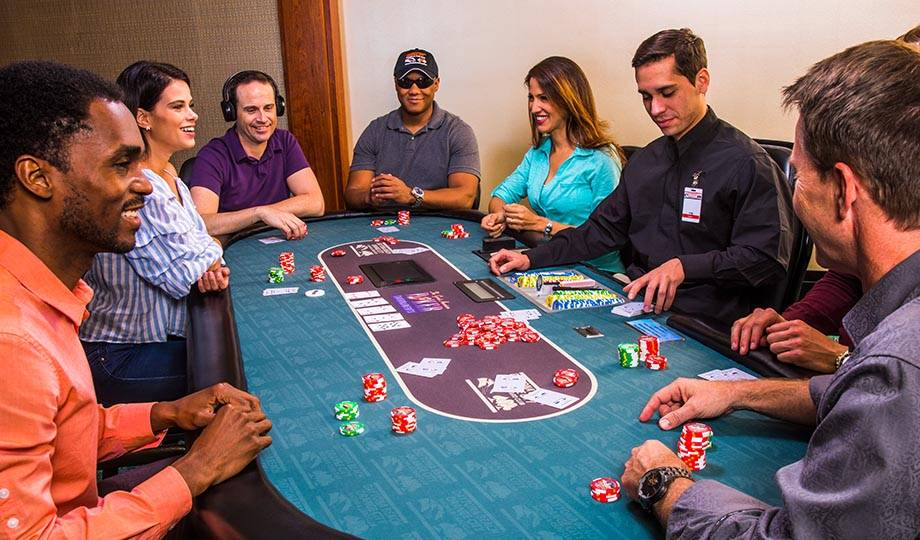 Crowded poker table, Orange City Poker Tournaments