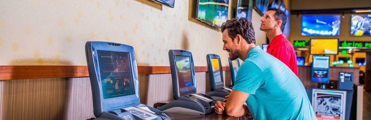 Guys at Simulcast Wagering Machines